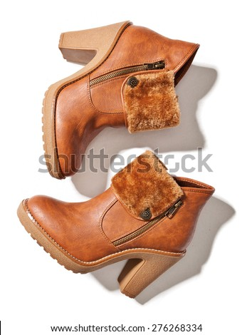 Brown female  boots isolated on white  - stock photo