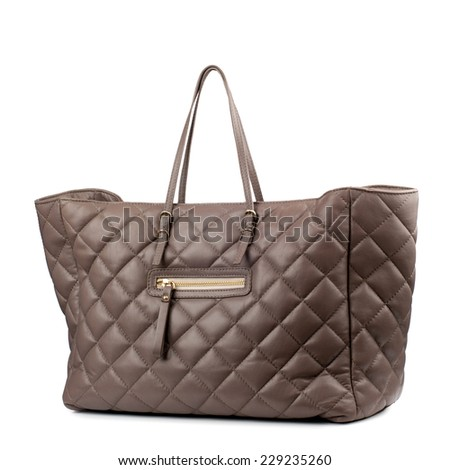 Brown female leather bag isolated on white background  - stock photo