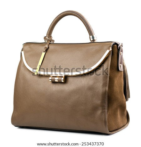 Brown female leather handbag isolated on white background.