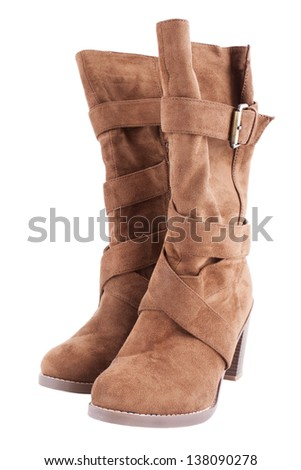 Brown female's boots isolated against a white background. - stock photo