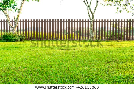 Brown Fence With Green Grass In Garden