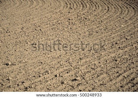 Brown field background with a round curve