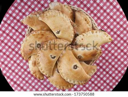 Brown Filled pastry in basket on round table  - stock photo