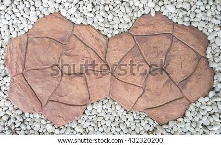 Brown flagstone walkway, a stepping big stone walkway, white garden stone. background - stock photo
