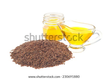 brown flax seed and linseed oil, isolated on white background - stock photo