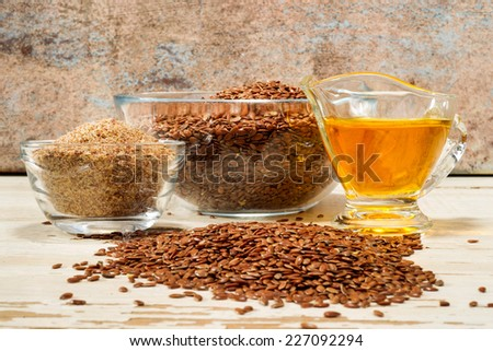 brown flax seed and linseed oil, selective focus - stock photo
