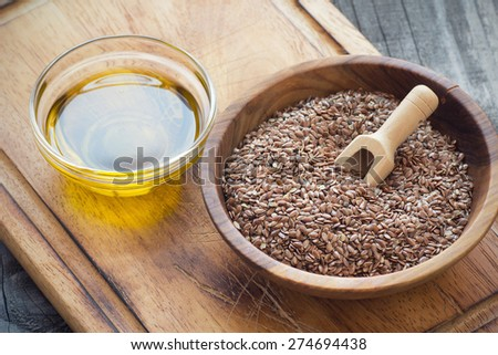 Brown flax seeds  and flaxseed oil - stock photo