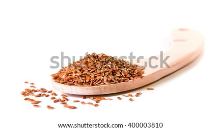 Brown flax seeds in wooden spoon on a white background - stock photo
