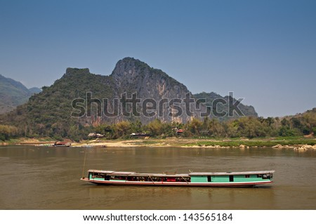 Brown flow of mighty Mekong river, South East Asia in hot summer day at dry season. - stock photo