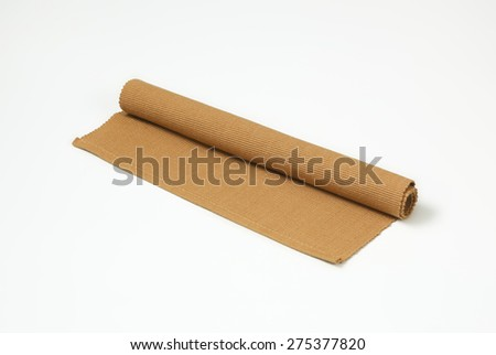 Brown folded napkin on white background