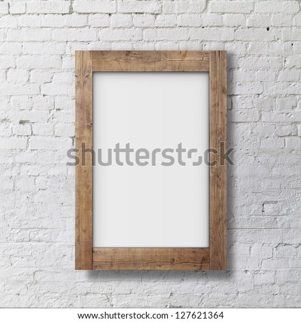 brown frame on brick wall - stock photo