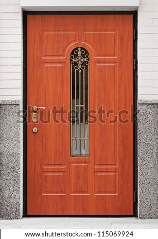Brown front door - entrance to the building - stock photo