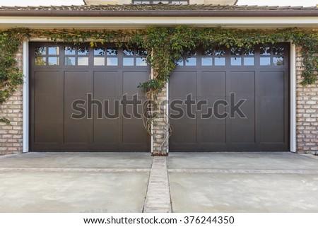 Brown garage door with windows - stock photo