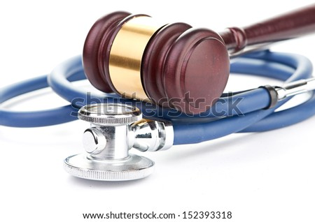 brown gavel and a medical stethoscope - stock photo
