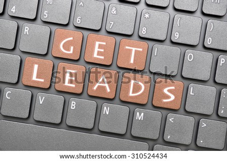 Brown get leads key on keyboard - stock photo
