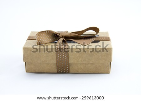 Brown gift box made of carton paper with a lace - stock photo