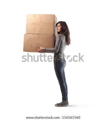 Brown girl holding some boxes - stock photo