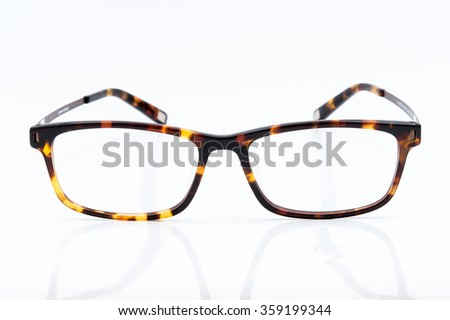 Brown glasses isolated on white background