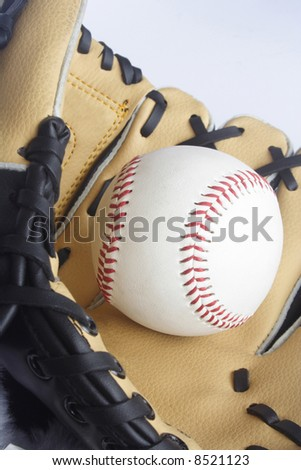 Brown glove and baseball on it - stock photo