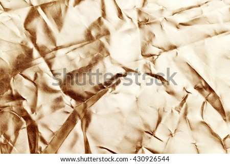 Brown gold  foil background with shiny crumpled uneven surface for texture and background - stock photo
