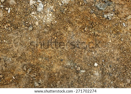 Brown ground surface as background in closeup - stock photo