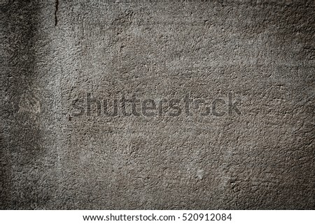 Brown grunge textured wall with dark edges