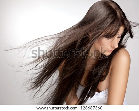Brown Hair. Beautiful Woman with Healthy Long Hair. - stock photo