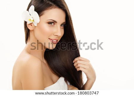 Brown Hair. Portrait of Beautiful Woman with Long Hair. High quality image.