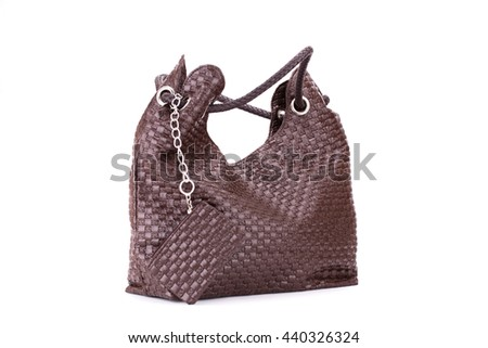 Brown handbag with wallet isolated on white background.