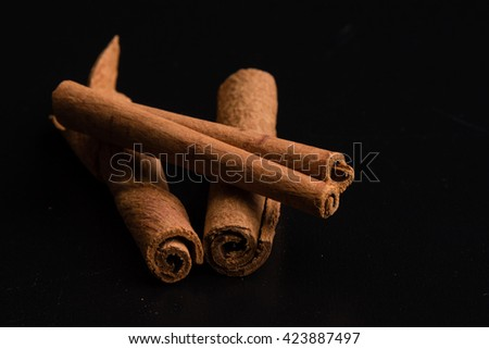 brown healthy cinnamon sticks spice on black table