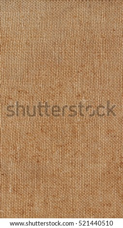 Brown hessian burlap texture useful as a background - vertical