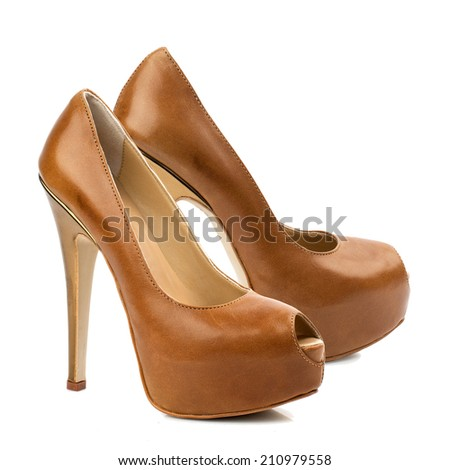 Brown high heel women shoe isolated on white background.