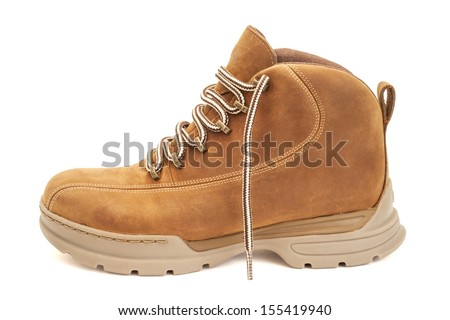 Brown hiking boot isolated on white with clipping path - stock photo