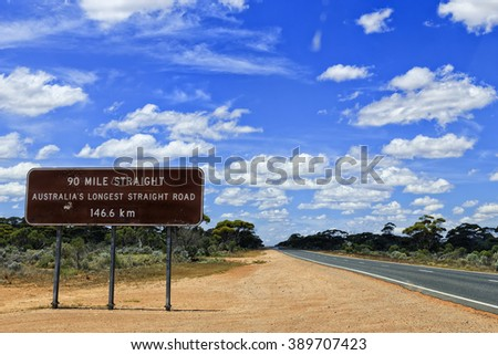 brown information roadsign in Western Australia nullarbor plain along Eyre highway about 90 mile straight road ahead