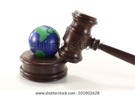 brown judges Gavel with colored globe on a light background - stock photo