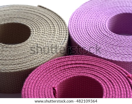 Brown, khaki and lilac hanks of Cotton Webbing