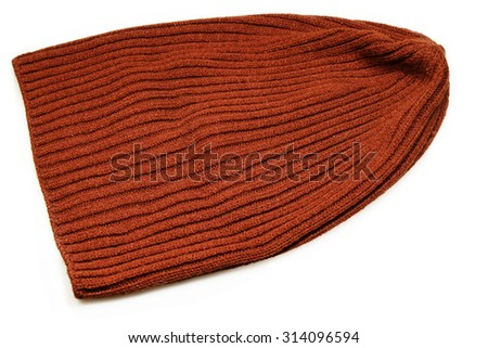 Brown knitted cap on a white background