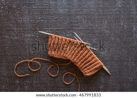Brown knitting on black background