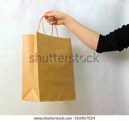brown kraft bag in hand - stock photo
