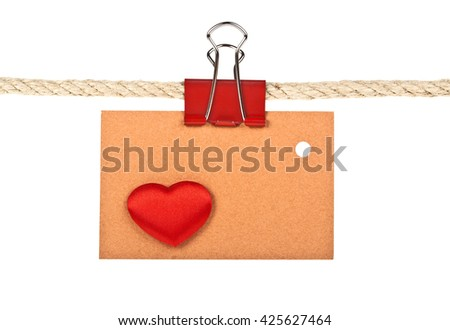 Brown label with heart on a rope isolated on white background, closeup - stock photo