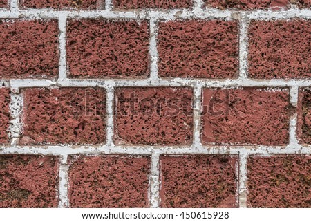 Brown Laterite block wall with white cement line