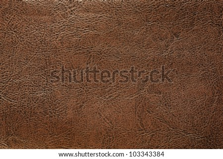 Brown leather background closeup - stock photo