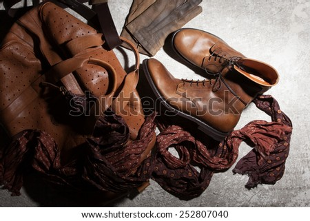 Brown leather bag and accessories on a dark background - stock photo