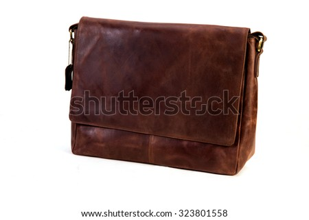 brown leather bag for executives clicked against a white background available with clipping mask