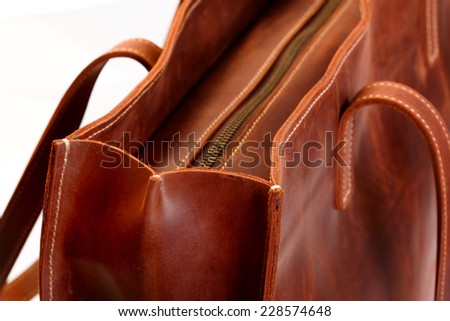 Brown leather boot or bag with zipper
