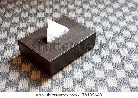 Brown leather box of tissue - stock photo