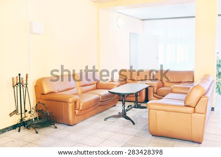 Brown leather chairs and sofa. Recreation room - stock photo