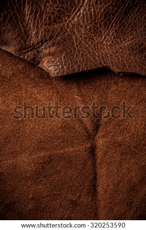 Brown Leather. Concept and Idea of Fine Leather Crafting, Handcrafts, Handmade, Handcrafted, Leather Industry. Background Textured and Wallpaper. Vintage Rustic Style. Vertical. - stock photo
