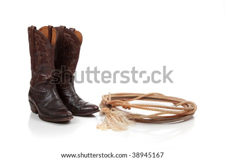 Brown leather cowboy boots on a white background