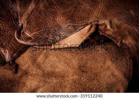 Brown Leather, Genuine. Concept and Idea of Fine Leather Crafting, Handcrafts Work Space, Handmade, Handcrafted, Leather Industry. Background Textured and Wallpaper. - stock photo